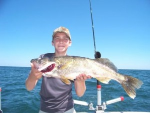 bring it on walleye charters puts another smile on the face of this young angler in ashtabula ohio waters of lake erie
