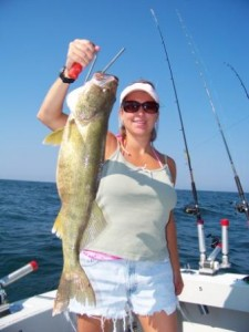 another young woman holding a trophy walleye taken on bring it on lake erie charters out of ashtabula ohio lake erie