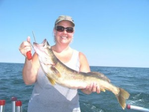 smiling faces and trophy lake erie walleye can be found while fishing on the bring it on walleye charters out of ashtabula ohio